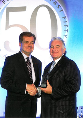 John Clark of The Whitestone Group Accepts the Business First Fast 50 Award