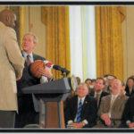 John Clark Sr looks on as President Bush shakes hands with Shaq.