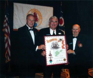 John D. Clark, Sr. accepts the Executive Order of the Ohio Commodore from Ohio Governor Ted Strickland (left) and Grand Commodore William Morgan (right.)